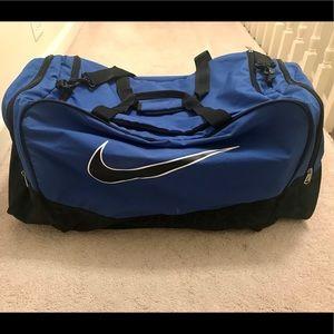 Large blue Nike duffel bag